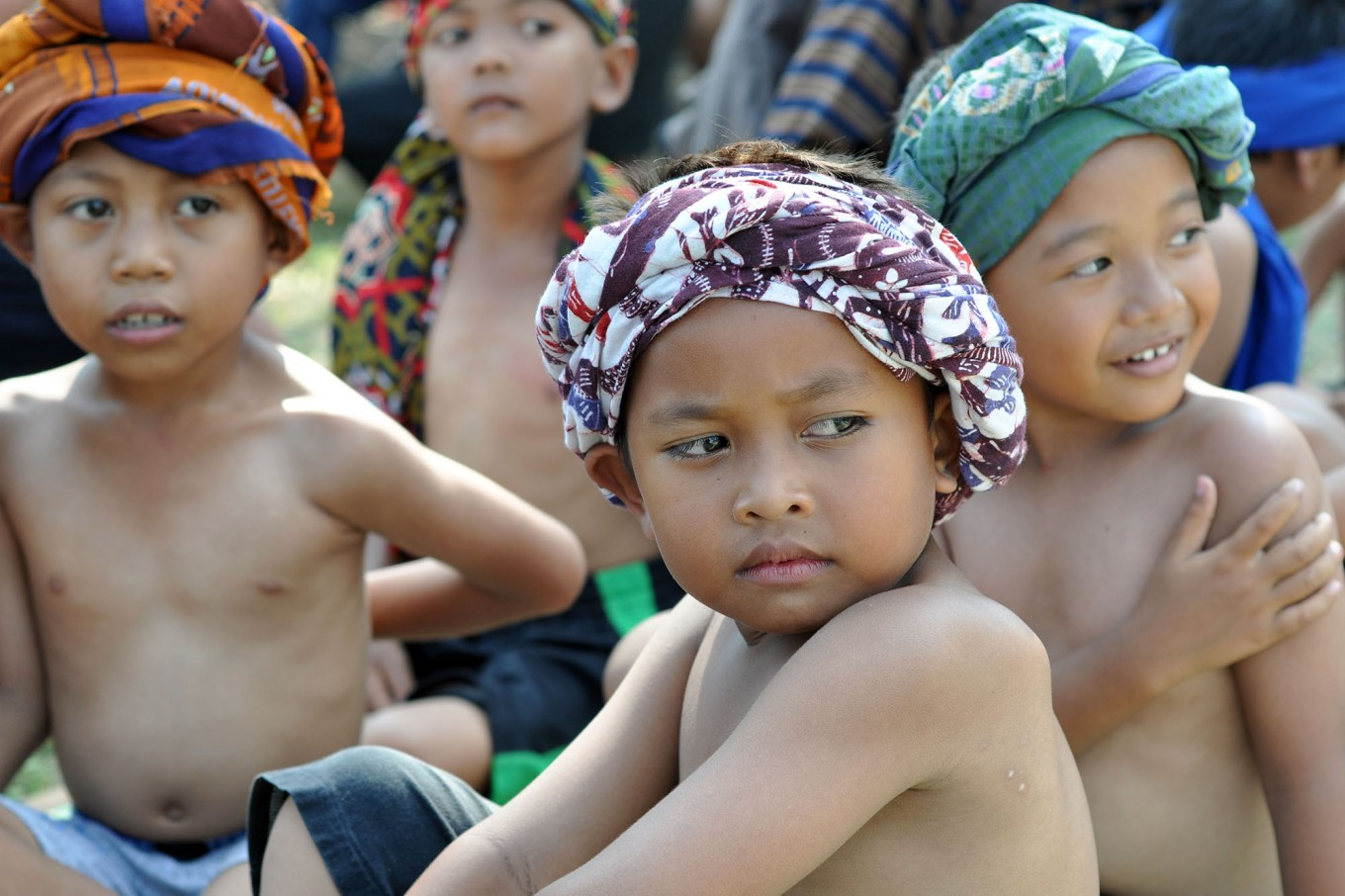 Several boys from the Sayuk Rukun Tibayan community in Klaten, Central Java, sit while waiting for their turn to perform the Tandur (to grow) dance. JP/Magnus Hendratmo