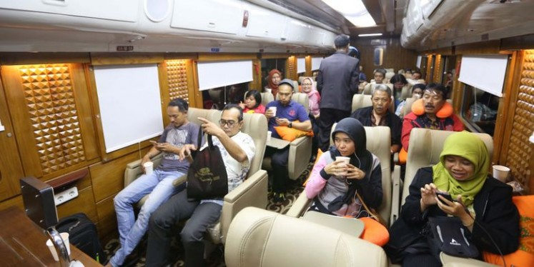 The passengers of a Priority car during a train trip to Yogyakarta on Aug. 4, 2017.