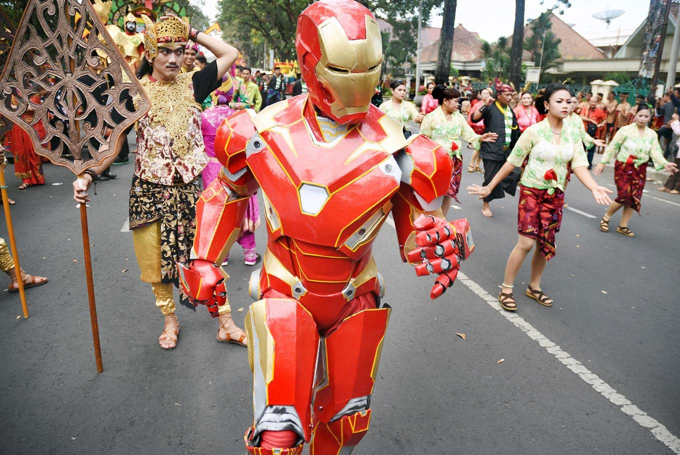 Stark difference: A participant performs in the Bandung group as Marvel's Iron Man.