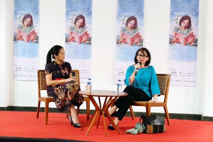 Modern thoughts: Karlina Supelli (right) talks with moderator Rike Amru in a discussion during the recent ASEAN Literary Festival in Kota Tua, West Jakarta.