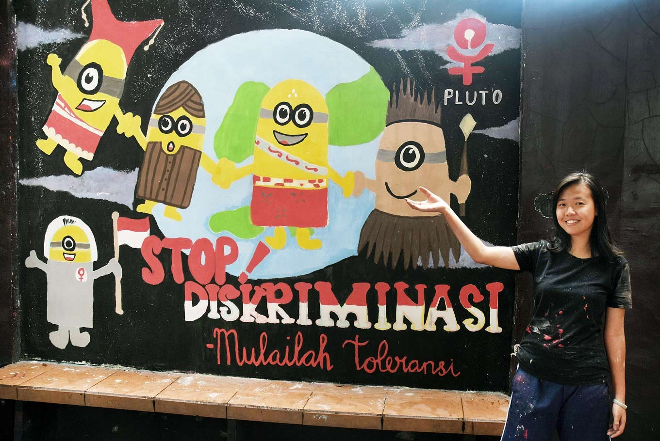 Minions: Stefani, a senior, presents a mural, which depicts the infamous minions in traditional Indonesian clothing.