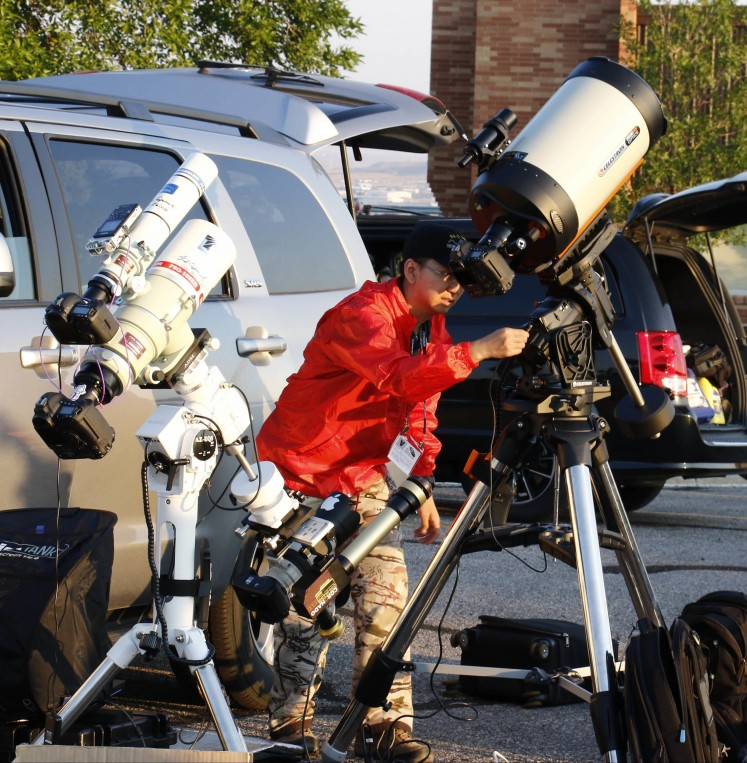 Astrocon attendees setup telescopes for the Great American Eclipse on August 21, 2017, in Casper, Wyoming. Emotional sky-gazers stood transfixed across North America Monday as the Sun vanished behind the Moon in a rare total eclipse that swept the continent coast-to-coast for the first time in nearly a century.