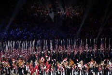 The Indonesian delegation (foreground) marches during the SEA Games opening ceremony. JP/Seto Wardhana