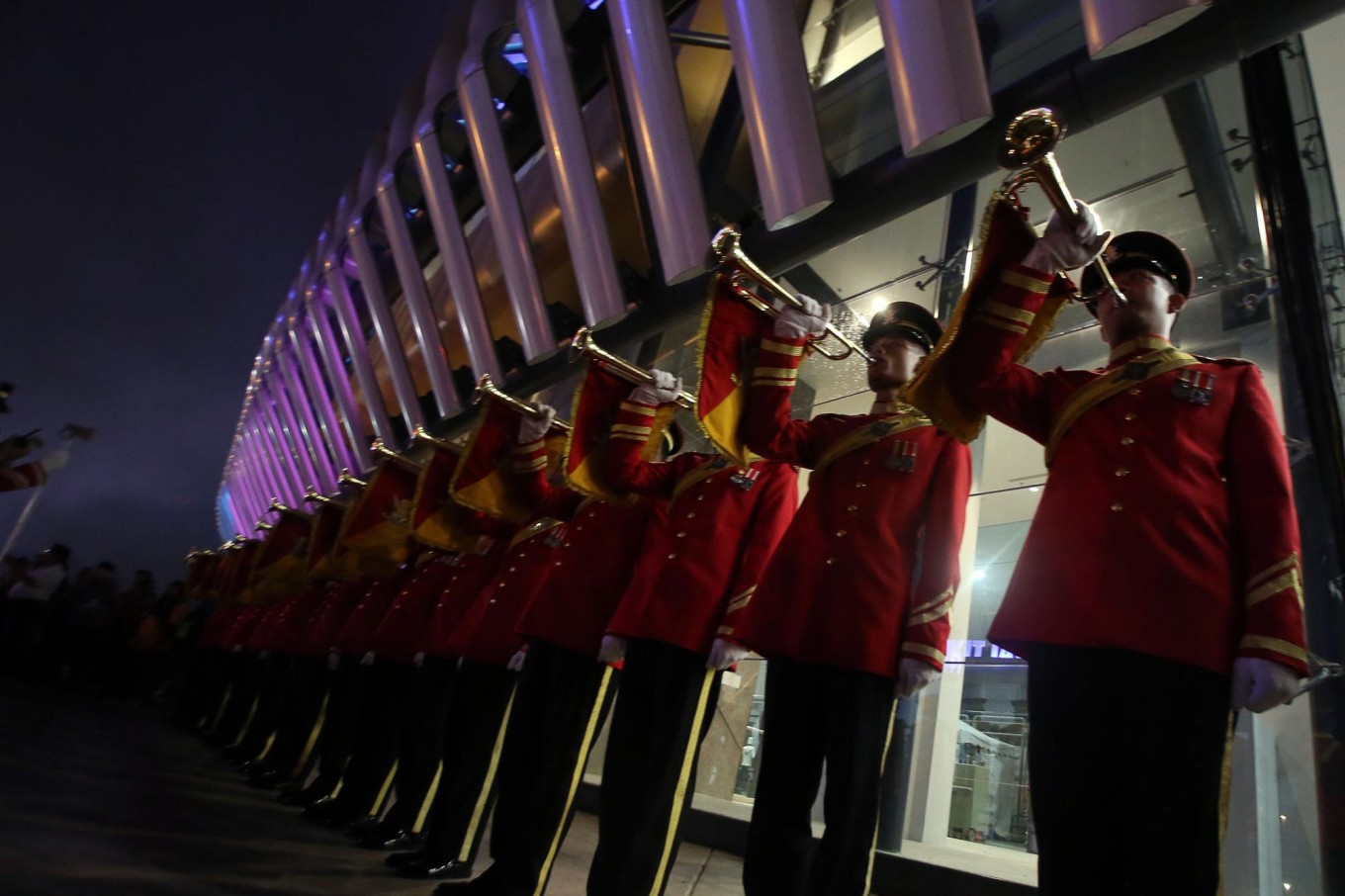 Trumpet squad plays its instruments as Sultan Muhammad V leaves the stadium after the opening of the SEA Games. JP/Seto Wardhana