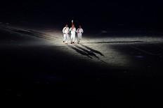 Torch bearers run their last lap during the SEA Games opening ceremony at the Bukit Jalil Stadium in Kuala Lumpur. JP/Seto Wardhana