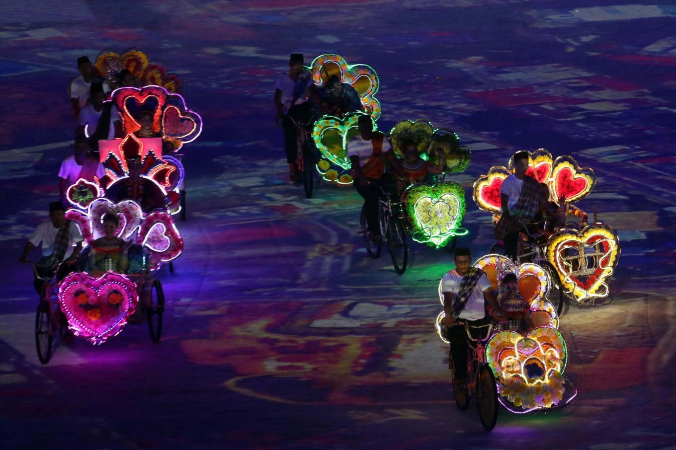 Dancers ride tricycles during their performance at the opening ceremony. JP/Seto Wardhana