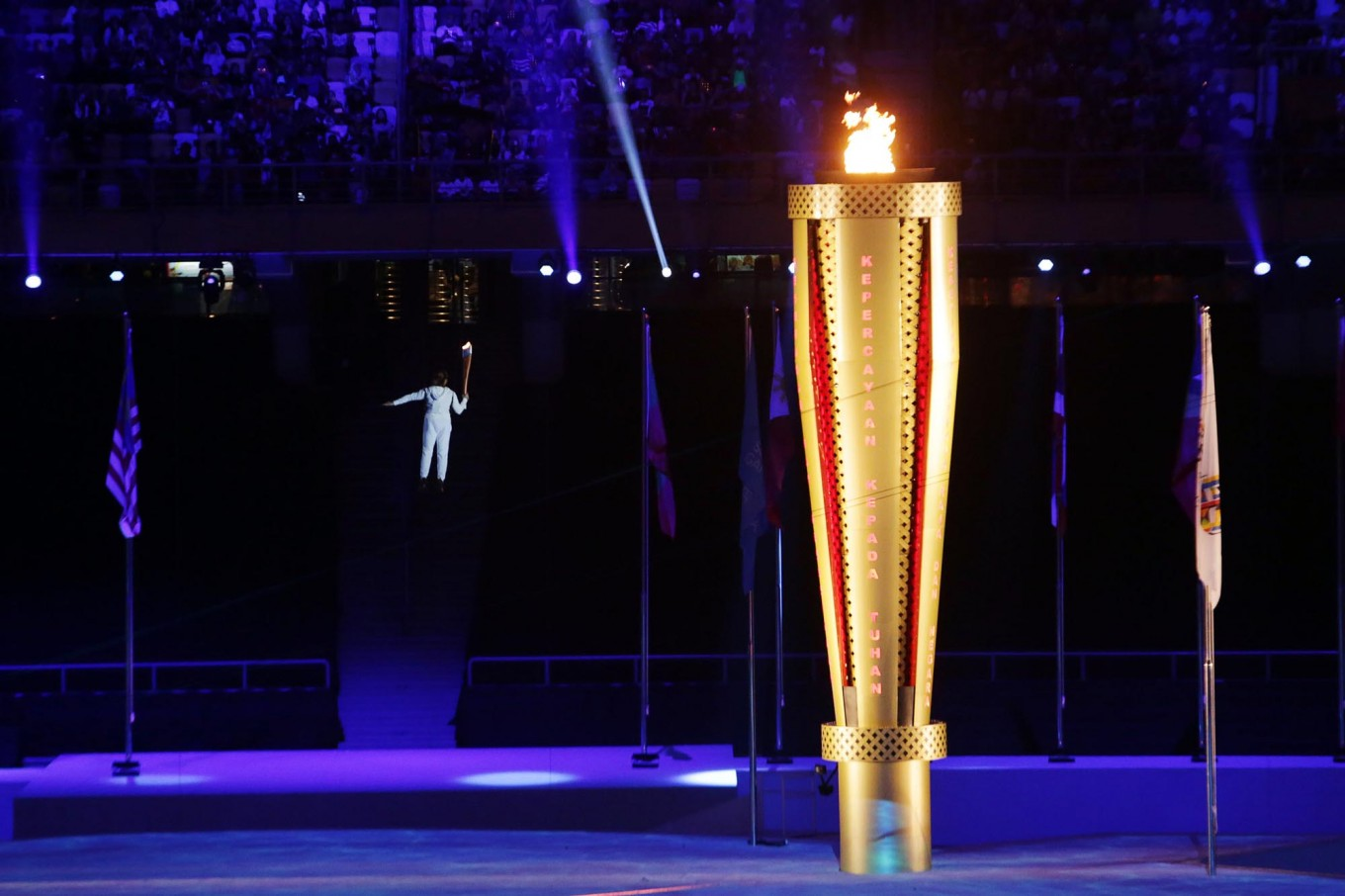 Malaysian athlete Nur Dhabitah Sabri is lifted with a wire to light the cauldron during the opening ceremony of the SEA Games. JP/Seto Wardhana