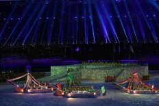 Dancers on board boats perform during the SEA Games opening ceremony. JP/Seto Wardhana