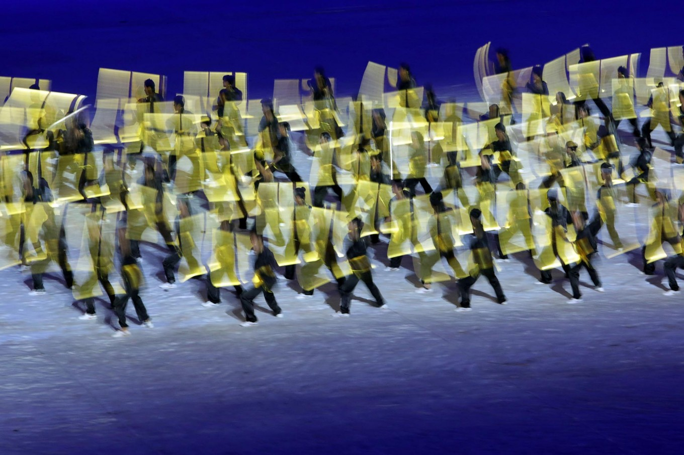 Dancers carry yellow boards during their performance at the opening ceremony. JP/Seto Wardhana