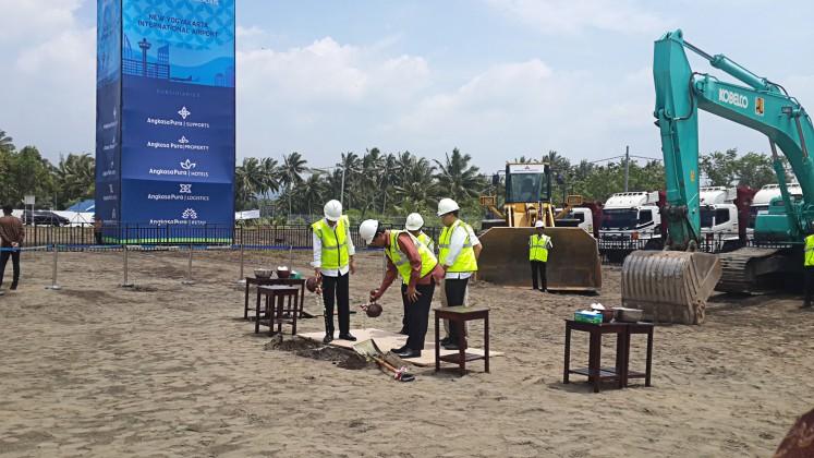 "Get ready: President Joko ""Jokowi"" Widodo (left) observes the first stone laid to mark the start of the construction process of a new airport in Kulon Progo, Yogyakarta, on Jan.27."