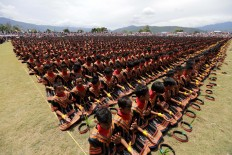 A total of 12,262 dancers perform the Saman dance at Blangkejeren stadium. JP/Hotli Simanjuntak