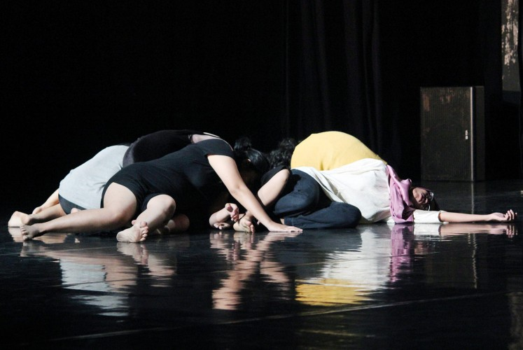 Body language: Dancers of CANdoDANCE lie on the stage during a preview of their contemporary dance.