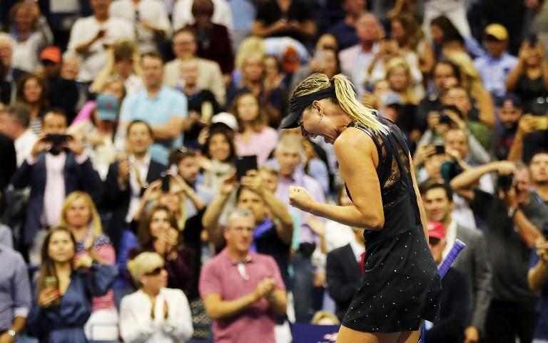 Sharapova wins Slam return, ousts Halep at US Open