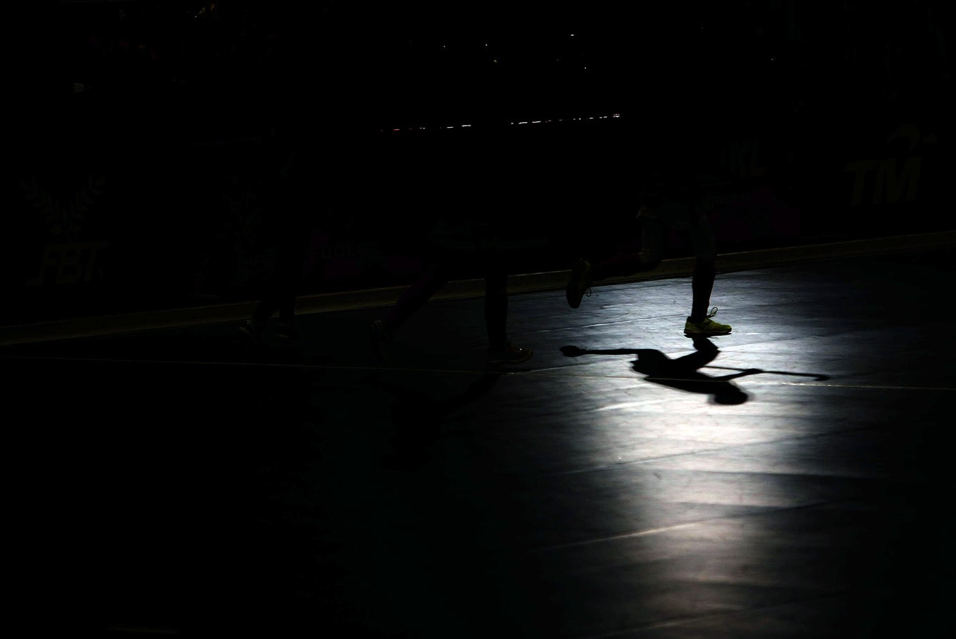Into the light: The shadow of Ika Oktavianti, an Indonesian indoor hockey player, can be seen as she and her teammates compete against Thailand during the 29th SEA Games women's indoor hockey match at MITEC, Kuala Lumpur. Indonesia's indoor hockey players had secured two silver medals as of Monday.