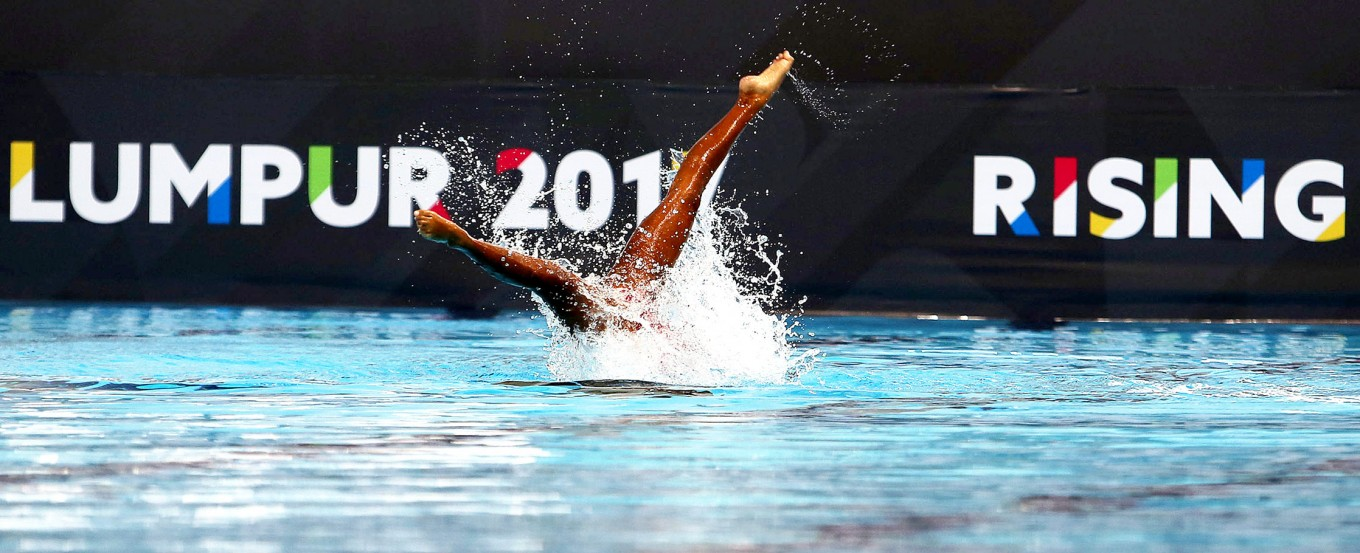 Hold your breath: Synchronized swimmers compete during the 29th SEA Games women's free routine synchronized swimming competition at MITEC, Kuala Lumpur. As of Monday, Indonesia's aquatics squad had won four gold medals, 12 silvers and 14 bronze medals.