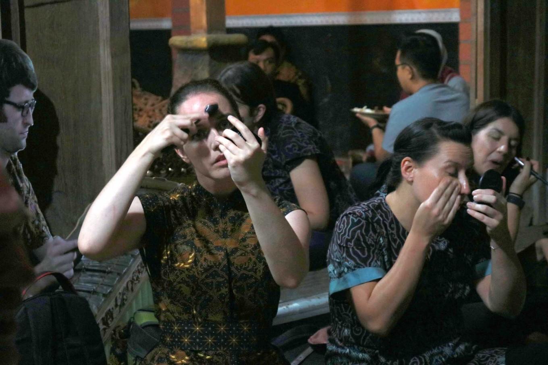 Female gamelan players put on makeup prior to their performance. JP/Maksum Nur Fauzan
