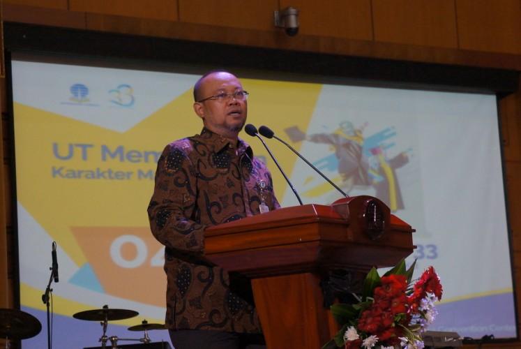 Universitas Terbuka Rector Ojat Darojat gives a speech during the university's 33rd anniversary celebration on Monday at the Universitas Terbuka Convention Center (UTCC) building in Pondok Cabe, South Tangerang.