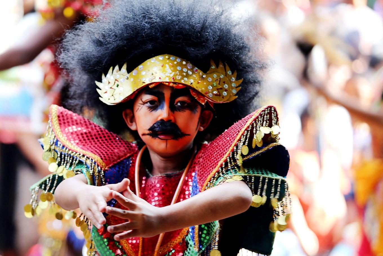 Dancing kid: A child performs kuda kepang (bamboo-horse dance) during the parade.