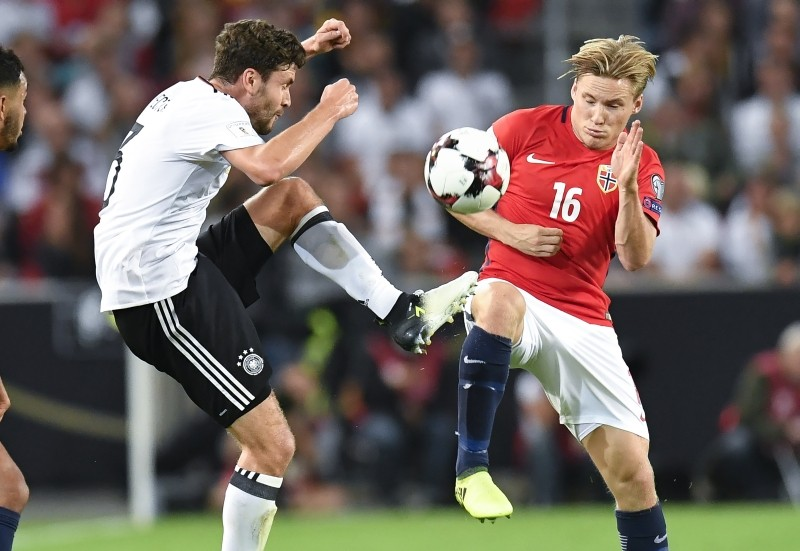 Germany rout Norway, but wait for Russia berth
