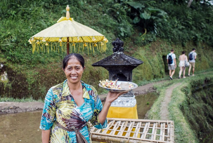 Daily offering: Vitri, a resident who lives in Sebatu village, Gianyar, says her family receives a monthly stipend to take care of their paddy fields.