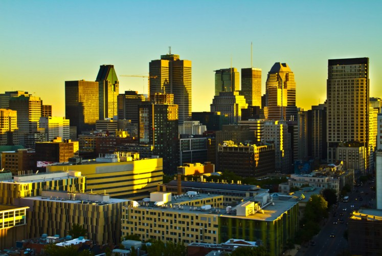 Montreal skyline bathed in sunset rays.