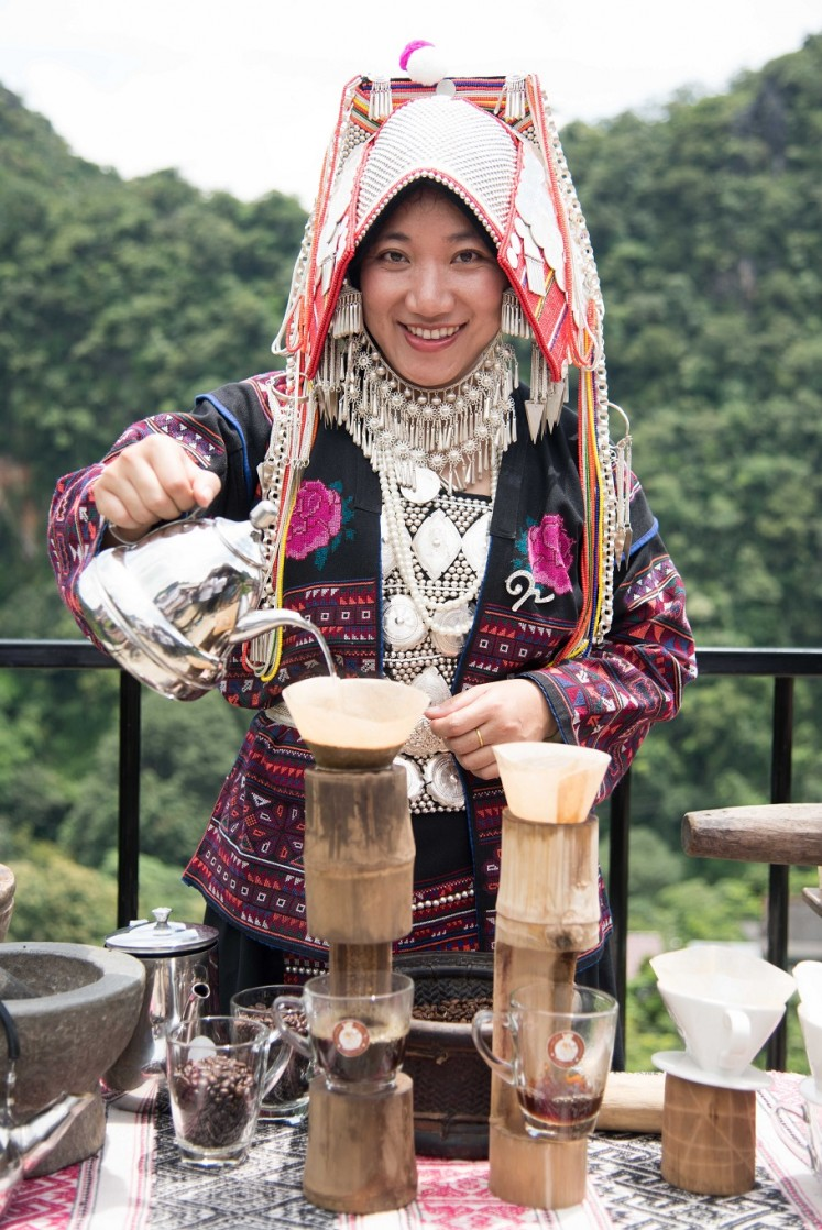 Coffee brewing is a part of the tourist activities on offer in Pha Mee village.