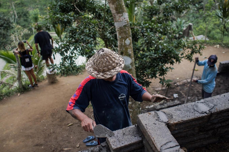 On progress: Wayan Arnawa (center) builds a simple kitchen around the paddy field tourist site in Ceking. JP/ Anggara Mahendra