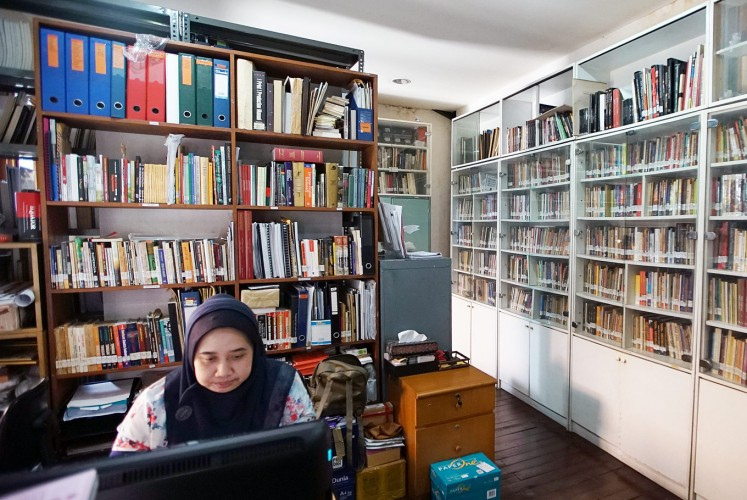 Getting immersed: A woman works in the library of the Lontar Foundation in Pejompongan, Central Jakarta.