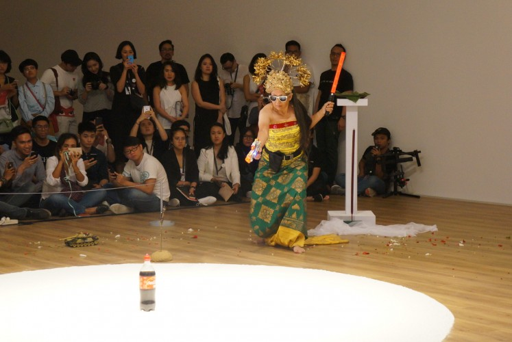 Indonesian artist Arahmaiani performs 'Handle without Care.'