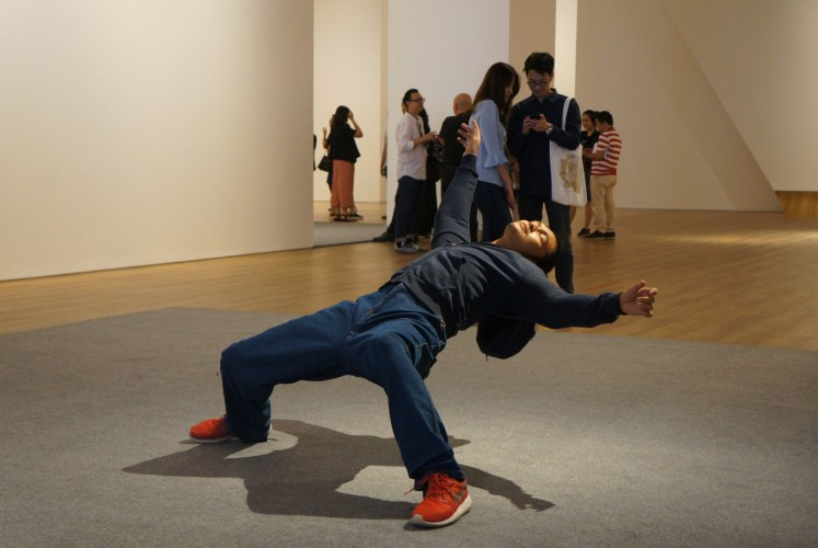 The art performance of 'In the Blink of an Eye' by China-based artist Xu Zhen.