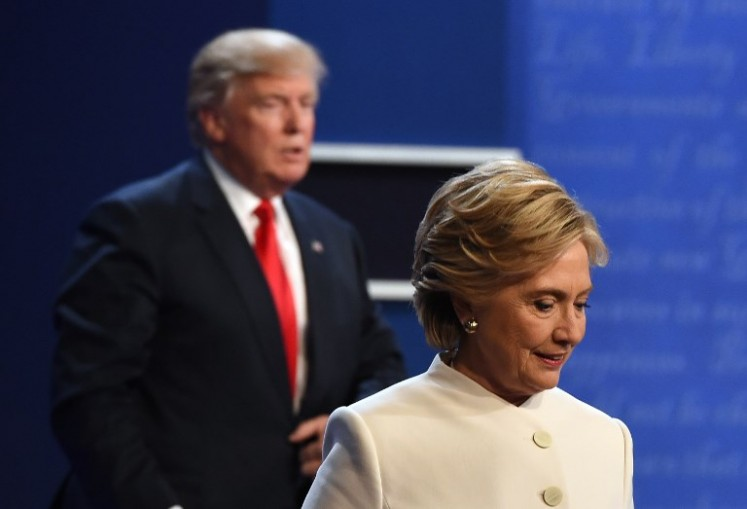 19 2016 shows former Democratic nominee Hillary Clinton and former Republican nominee Donald Trump walking off the stage after the final presidential debate at the Thomas & Mack Center on the campus of the University