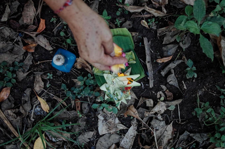 Nyoman presents the offerings consisting of colorful rice. JP/Anggara Mahendra