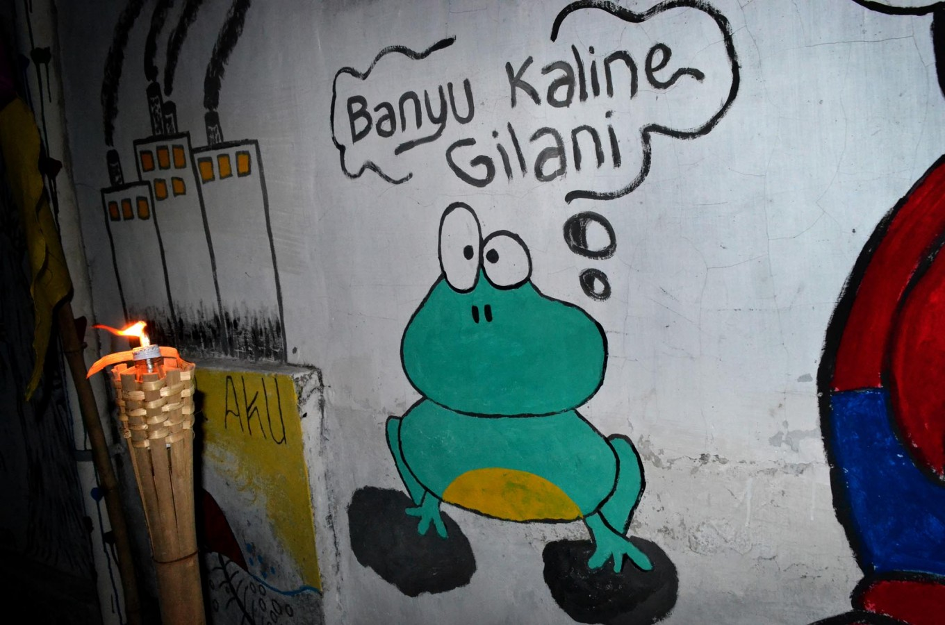 During the festival's pre-event activities, the walls of Baron Cilik kampong were painted with environmental murals, including the illustration of a frog protesting the polluted condition of the river. JP/Stefanus Ajie