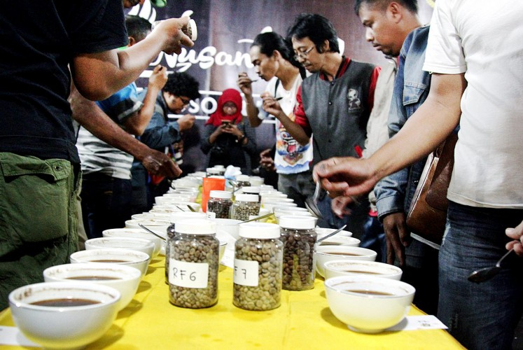 Take a sip: Visitors participate in a coffee-tasting event featuring the produce of coffee farmer groups from 132 regions across the archipelago.
