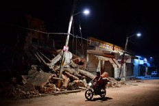 A man rides his motorbike in Juchitan de 