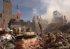 In this photo obtained 18 September 2001 from the Federal Emergency Management Agency (FEMA), firefighters and Urban Search and Rescue workers battle smoldering fires as they search for survivors at the ruins of the World Trade Center in New York 13 September 2001.  Rescue and recovery work continues at the site of the devastation in downtown Manhattan but hopes of finding anyone alive in the ruins of the World Trade Center have almost faded, New York Mayor Rudolph Giuliani said 18 September, one week after the terrorist attack that toppled the twin towers.  AFP/ FEMA/ Andrea Booher