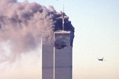 A hijacked commercial plane approaches the World Trade Center shortly before crashing into the landmark skyscraper 11 September 2001 in New York.  AFP/ Seth Mcallister