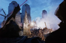 Early morning light illuminates the wreckage of the World Trade Center 25 September, 2001 in New York. Search and rescue efforts continue in the aftermath of the 11 September terrorist attack.  AFP/Eric Feferberg