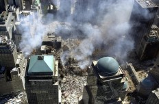 This photo released 17 September 2001 by the New York City Office of Emergency Management shows smoke rising from the ruins of the World Trade Center in lower Manhattan, New York 16 September 2001.   AFP/ NYC office emergency management/ HO