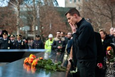 A family member of a victim of the 1993 World Trade Center bombing lays a rose at the 9/11 Memorial on February 26, 2016 in New York, NY. On the the 23rd Anniversary of the bombing, family members of the victims gathered to remember the 6 deaths and over 1,000 injuries that resulted from the 1993 bombing.   AFP/ Getty Images/Bryan Thomas