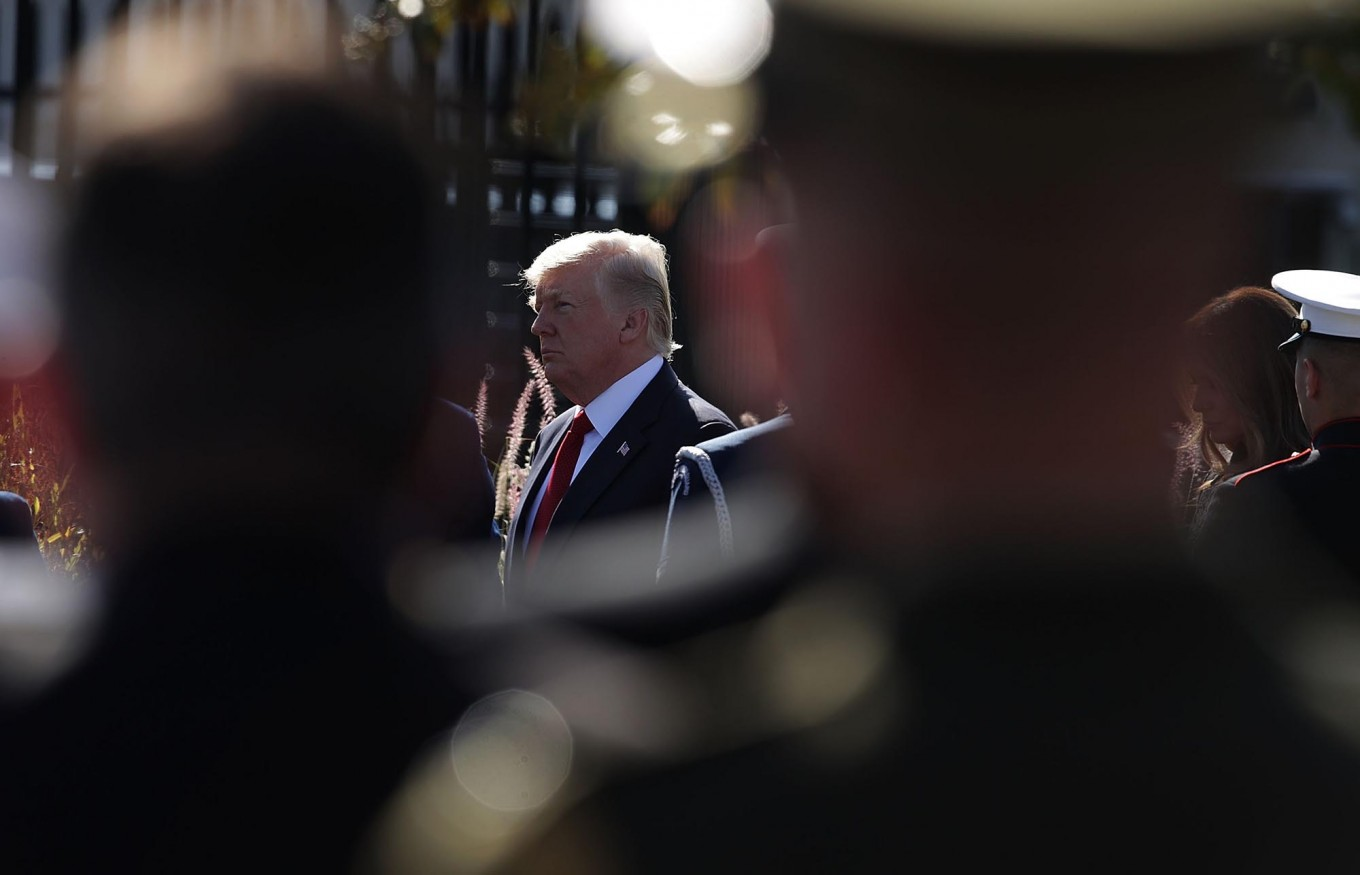 U.S. President Donald Trump arrives at an observance to commemorate the anniversary of the 9/11 terror attacks at the Pentagon Memorial September 11, 2017 in Arlington, Virginia. The nation marked the 16th anniversary of the terror attacks that took almost 3,000 lives.  AFP /Getty Images/ Alex Wong