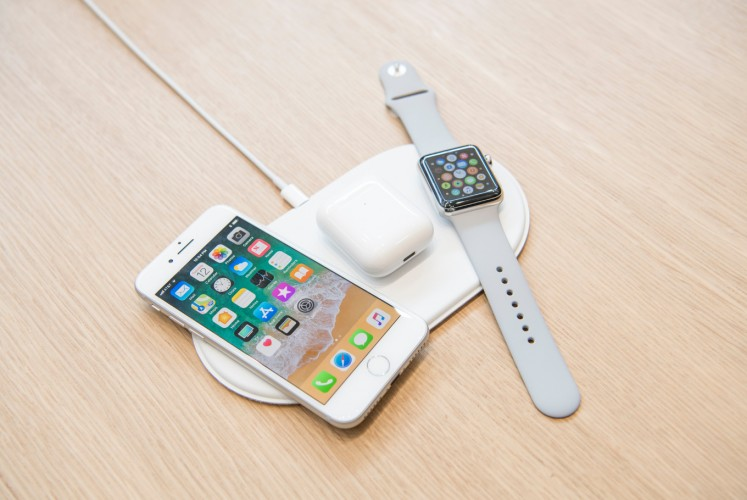 The Apple iPhone 8, Airpods, and Apple Watch on the AirPower charger.