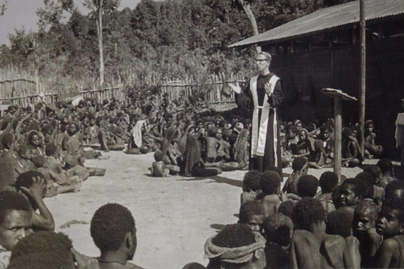 Old times: Father Frans Lieshout OFM delivers a sermon in Bilogai, now located in Intan Jaya regency. The church's early entry into Papua was not smooth. A missionary school was burned by locals in Baliem Valley in 1961. Courtesy of  Brother Jan Sjerp OFM, Father Lambertus H Hagendoorn OFM and Father Frans Lieshout OFM