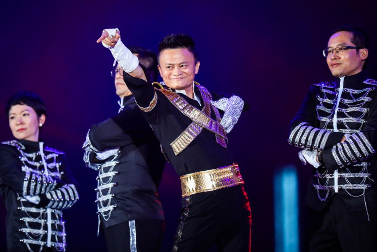 This photo taken on September 8, 2017 shows Jack Ma, chairman of Alibaba group, dancing to a medley of Michael Jackson songs during the Alibaba Annual Party at the Huanglong sports center in Hangzhou in China's eastern Zhejiang province. Ma danced with other Alibaba employees during the party, which was held to celebrate the 18th anniversary of the company's founding.