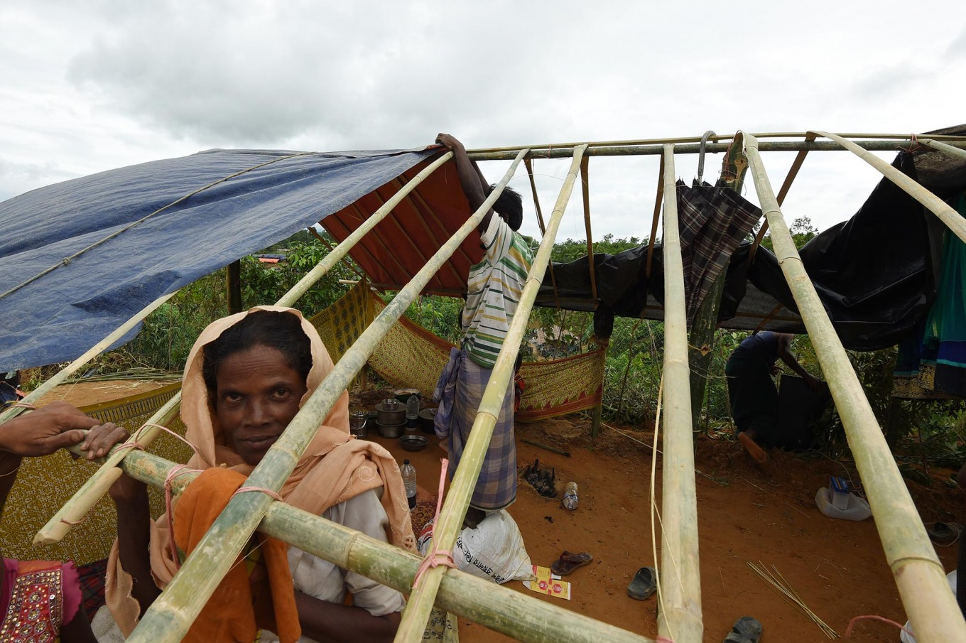 Rohingya refugees build a new makeshift shelters in the refugee camp of Thyangkhali near the Bangladeshi village of Gumdhum, on September 18, 2017. 