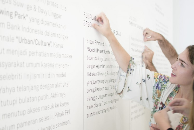 An visitor attends the opening of the Unsung Museum at ROH Projects, Jakarta.