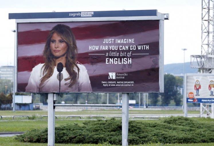 A billboard advertisment for the American Institute school in Zagreb featuring an image of the US First Lady Melania Trump with a caption that reads,