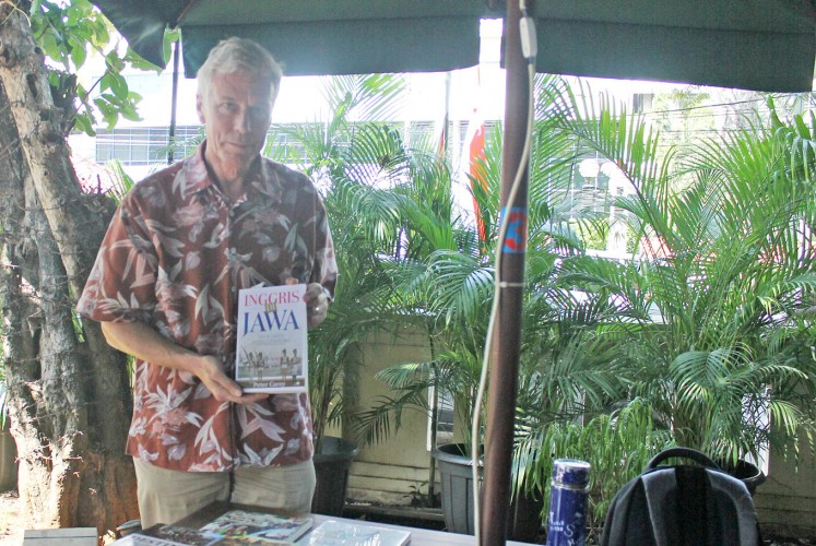 Translated: Peter Carey poses with the Indonesian-language edition of his book, The British in Java, 1811-1816.