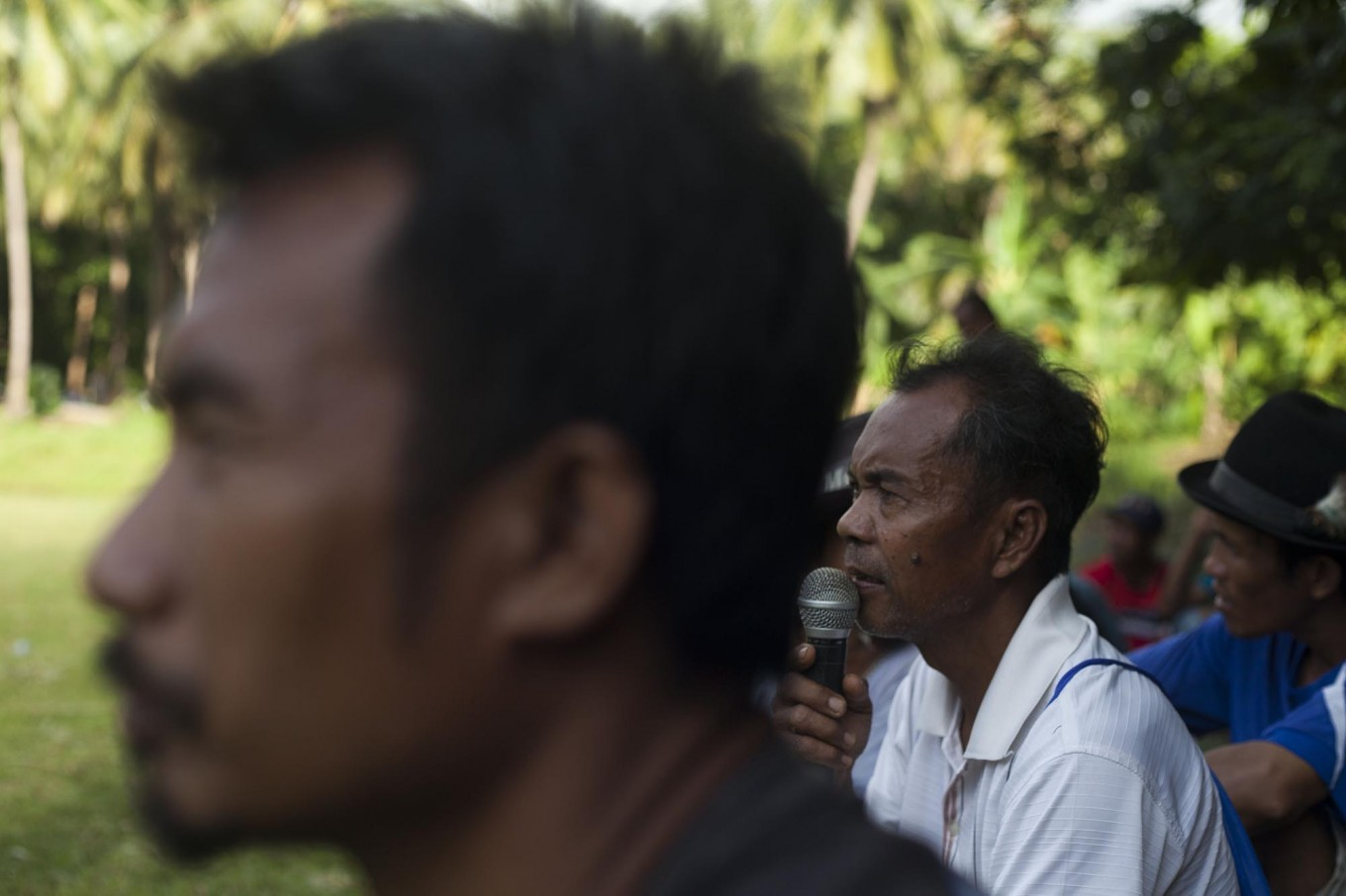 A man shouts instruction through a microphone at the event. JP/Sigit Pamungkas