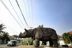 Immortalized: A Javan rhino statue stands tall in front of the Ujung Kulon National Park in Pandeglang, Banten. JP/Dhoni Setiawan
